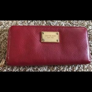 Red soft leather Michael Kors zip around wallet